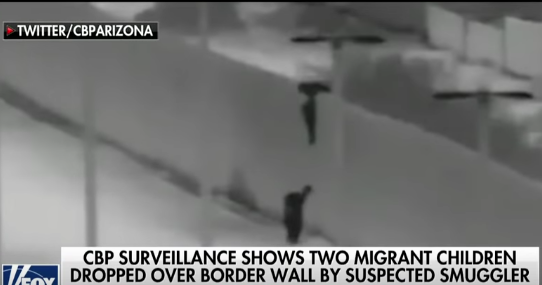 MigrantsOverFenceYumaDec2018